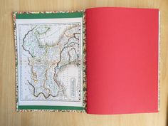 Italian Themed A4 Notebook with lined pages.  Florentine paper cover, lined with Murano art paper and an antique map of Italy. Red & green section guards and white linen binding. Red & white label mounted on front cover. By LizzieMade Hand Bound Books