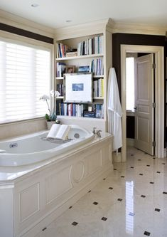 Like the floor, woodwork around tub, but a bookshelf? I don't think so.  Like the separate toilet room