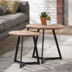 Both tables feature a table top made of acacia wood and a frame of black, powder coated metal. Industrial design combines metal and wood. Suitable for every interior. Available at Furnwise! Round Wood Table, Round Table Top, Coffe Table, Coffee Table Design, Metal Furniture, Table Furniture, Style Deco, Nesting Tables, Small Tables