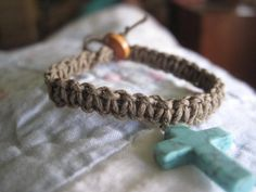 Child's hemp bracelet with cross charm.