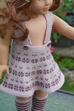 Lovely knitting pattern for your doll in 2 lilac colors
