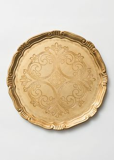 "Florentine charger plate, custom gilded and hand painted in Florence, Italy utilizing a gold-leaf finishing process dating back to the 13th century.    DETAILS 13""  Wood / Gold-leaf  Made in Italy   Clean with a damp cloth   Ships in 3-5 business days   A CDP DESIGN EXCLUSIVE"