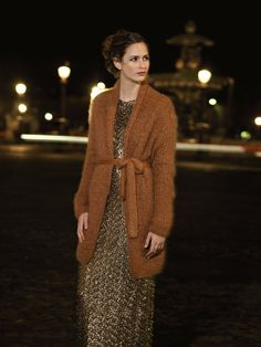 Chunky sweater over sparkly dress.