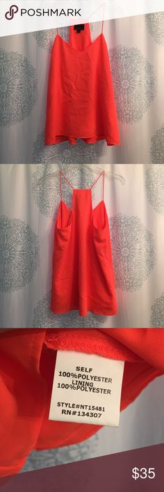 Tank Orange spaghetti strap racerback tank. Flowy and made of 100% polyester. New without tags. In perfect condition! Tops Tank Tops