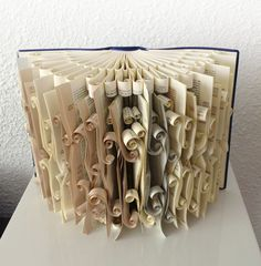 Book Art Sculpture. I would never do this to a book, but still cool!