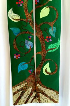 Tree of life. Great for ordinary time. Silk fabric with batik and cotton applique and embroidery.