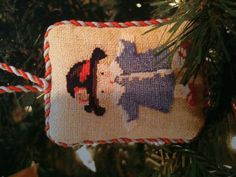 tiny needlepoint stitches in Christmas ornament