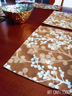 "placemats using heavy decorator or ""outside"" fabrics. could make them reversible."