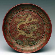 DISH WITH DRAGON, Ming dynasty (1368 – 1644), dated 1595, red lacquer with filled-in and engraved-gold-decoration
