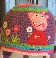 Peppa Pig hat.  Pig and flowers made with floss.