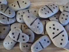 The joy of natural elements... domino rocks. Use idea from sharpies on dollar store plates and put in oven.