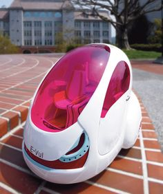 E-Vul Electric Car. If you're gonna go about looking ridiculous in an electric pod, you may as well do it in pink.