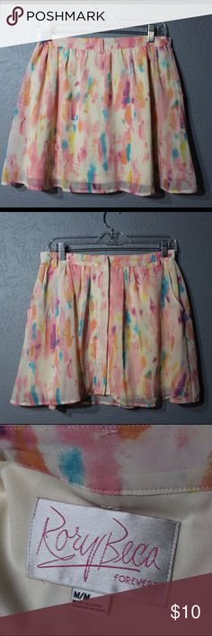 """Watercolor Easter pastel skirt Has pockets!!! And belt loops!! Fully lined, see pics. Snap buttons all the way down. Waist is 15"""" and length is a little over 16"""". Sits just above hips, hits mid-thigh. Not too short for Easter brunch with the family, but short enough to be just right! Pair this with a nice chambray shirt tied in the front, a big sun hat, and some leather sandals! Or, wear it over a one piece swimsuit and you can go from brunch to the pool! Rory Beca Skirts Circle & Skater"""