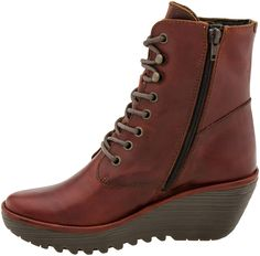 Buy the Fly London Ygot Wedge Boot at PlanetShoes.com. Discover Fly London shoes, the brand of universal youth fashion culture at PlanetShoes.com, your trusted source for feel-good footwear, with free shipping & returns! (Brick)