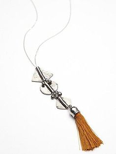Pushkar Tassel Pendant | Silver chain necklace with ethnic plates and bead dangles with a statement tassel. *By Banjara