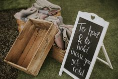 Make sure guests don't get cold at your outdoor festival themed wedding by providing them with blankets to keep warm!