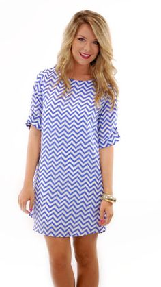 Cute casual summer dress. If it were up to me, I would've used a bright pink belt and tied it around my waist. Then, I would've worn some bright pink flats or sandals.