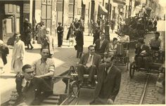 """""""Taxis"""" in the Warsaw Ghetto. In the absence of motorcars, human power was employed. Note the attractive, well dressed young lady riding in the background taxi. Was she leaving the ghetto? Highly unlikely. We will never know."""