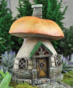 Give petite pixies a space all their own with this darling fairy cottage. Nestled among the blooming buds and lush greenery of a flower bed or garden, this pretty piece adds a pinch of magic wherever it's placed. 7.5'' H x 6.5'' diameterPoly-resinImported