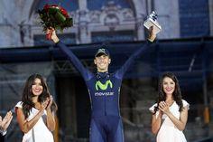 Vuelta a España 2014 - Stage 21: Santiago de Compostela (ITT) - blank 9.7km photos - Adriano Malori (Movistar) winner of the final stage TT shows his pride amongst the glamour of the podium girls!