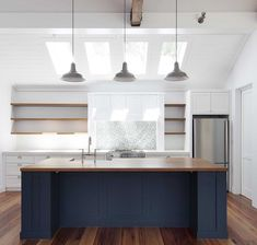 island navy kitchen island paint color this navy island works perfectly with the Timber countertop Navy island paint color Porters Paints Mariner Navy Kitchen Cabinets, Kitchen Cabinet Colors, Kitchen Paint, New Kitchen, Island Kitchen, Kitchen Rug, Kitchen Ideas, Kitchen Counters, Kitchen White