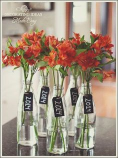 - graduation party decorating ideas grad parties graduation ideas graduation party table ideas these are so simple and perfect for a graduation party centerpiece maybe a different flower but love the an Graduation Table Decorations, Graduation Party Planning, College Graduation Parties, Graduation Celebration, Graduation Party Decor, Grad Parties, Graduation Ideas, Graduation Centerpiece, Graduation Gifts