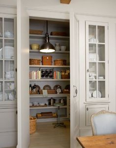 pantry doors flanked by built-ins for china storage