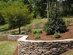 retaining wall ideas | Smaller stones can be transported via wheelbarrow and moved into ...