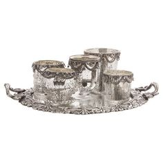 Set of 5 mercury glass candleholders with a matching tray.  Product: Tray and 5 candleholdersConstruction Material: ...