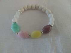 """Czech Glass Bead Diffuser Bracelet w/Natural Lava Stone - Item #BR-027 Price: $14  This is a 8mm lava stone bracelet, stretchable. The beads are made from natural lava stone, rare Czech stone, glass and acrylic. Colors: Purple, Yellow, Pink, Green, and White. . Women's Length: 7"""" fits average women's wrist."""
