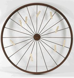Bike Rim Card Holder.....This could be really cute with the shutters.  Will have to keep my eyes open for rim at the flea market.