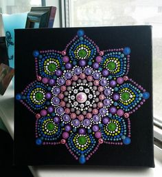 Very pretty hand painted Dot Mandala painting on a 6 x 6 stretched canvas embellished with 8 Swarovski Crystals and adhesive center gem. A treasured gift or keep for yourself to enjoy! Free shipping on orders over $ 50. through Dec. 31, 2017