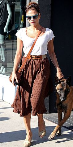 @72 EVA MENDES  Retro pieces can end up looking costumey, but Eva's calf-length brown skirt, cork wedges and throwback sunnies feel fresh with her classic white tee and modern double-buckle belt.