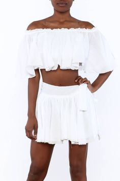 82c97ea855cbb White off-shoulder crop top with short sleeves and raw edges. Off-Shoulder.  Shoptiques