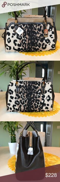 """COACH MADISON KIMBERLY CARRYALL *NWT* This Madison is in an ocelot fabric print with a beautiful red lining.  **Comes with original dust bag**  Serial no. D1373-25207  Length: 15 3/4""""      Drop/shoulder handle: 8"""" Width: 6"""" Height: 9 1/2""""  Full length exterior slip pocket, full length central zip compartment, magnetic closures - one on each side, interior zip pocket and 2 interior slip pockets. Large bag and great for work and travel. The ocelot fabric print makes this a great bag for any…"""