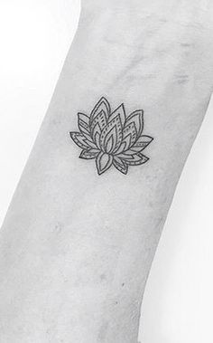 Small lotus done by jonboytattoo