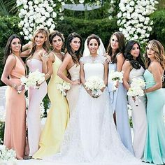 Pretty pastel bridesmaid dresses that compliment each other well.  @Jessicaclaire