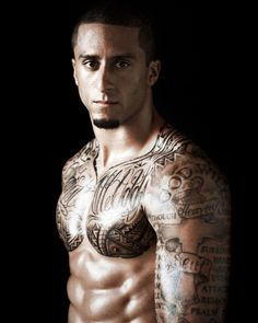 Colin Kaepernick, San Francisco 49ers...I'm not one for tattoos, BUT...love me some of this QB! Damn he fine!!
