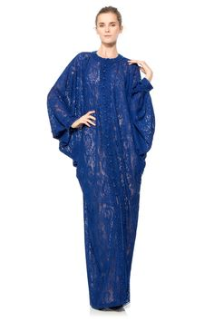 Cut a stunning silhouette in our lavish corded lace caftan that boasts dolman-draped sleeves and a beaded ornamentation that trims both the center front, from neckline to hem and finishes the sleeve hems. The caftan's rich, vibrant blue hue will surely tu Kaftan Style, Caftan Dress, Ankara Dress, Abaya Designs, Abaya Fashion, Fashion Dresses, Abaya Mode, Tadashi Shoji Dresses, Hijab Stile