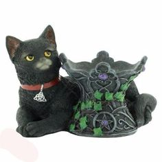 A cute little witches cat called Cosmo laying besides a crystal ball Holder ( crystal ball sold seperatley). The crystal ball holder has beautiful detail and decorated with purple gems and green climbing ivy. A Nemesis Now product. Cat Statue, Witch Cat, Here Kitty Kitty, Tealight Candle Holders, Coven, Crystal Ball, Cat Gifts, Cosmos, Cats And Kittens