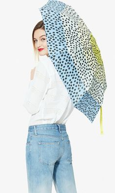 Make a drizzly, dreary day instantly better by popping open this cheery dotted umbrella. ==