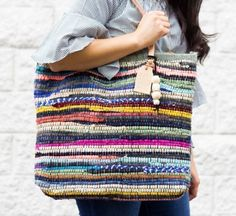 Rag Rug DIY Tote Bag | Turn a dollar store rag rug into a chic and colorful tote bag for summer with this tutorial for how to sew a bag! #diyragrugbag #diyragrugtutorial #diybag