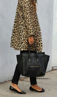 .Animal print coat with black pants and chic ballerinas