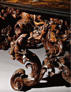 A PAIR OF ITALIAN IVORY, STAINED HORN AND PEWTER-INLAID EBONY, ROSEWOOD, WALNUT, FRUITWOOD AND MARQUETRY CONSOLE TABLES, THE TOPS SIGNED BY LUCIO DE LUCCI, THE STAINED BOXWOOD BASES ATTRIBUTED TO ANDREA BRUSTOLON (1662-1732), VENETIAN CA 1686, sothebys