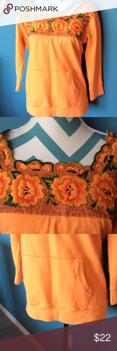 Lucky Brand Orange Die Cut Sweatshirt Lucky brand orange sweatshirt with one front pocket three-quarter sleeve ps on the square neckline is a lovely  embroidered floral pattern with diecut leaf scalloped edge around the square neckline beautiful quality in excellent condition Lucky Brand Other