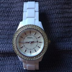 Fossil watch with new battery I bought on P M its just not my style. It is great condition. I put new battery in yesterday. No missing stones and has extra links. Comes with paperwork and box   Perfect for summer! Fossil Accessories Watches