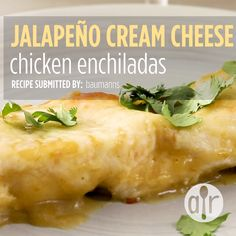 "Jalapeno Cream Cheese Chicken Enchiladas | ""One of my favorite local Mexican restaurants serves a dish with jalapeno cream cheese and shredded chicken that is to die for. I get nothing but rave reviews from people who try it!"" #mexicandishes #mexicanrecipes #recipes  #enchiladas #dinnerrecipes #dinnerideas #enchiladas #chicken #chickenrecipes #chickenenchiladas"