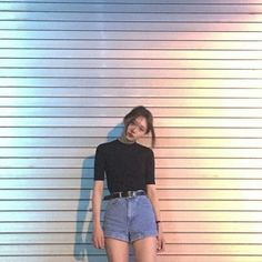 The outfit, the hair, the background - everything screams simplicity. I especially want to pay attention to the opalescent lighting that somehow highlights the main subject of the photo