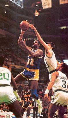 Magic Johnson shoots over Kevin McHale