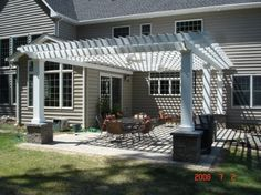 We need a pergola like this for a little shade, to add some dimension to the back of our house, and to hang a porch swing!
